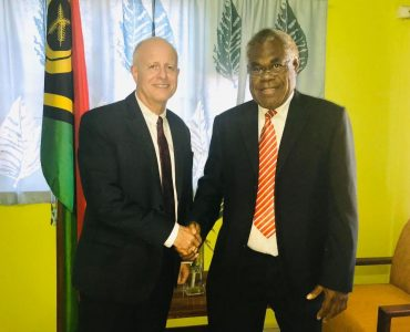The new Justice Minister welcomes the first member of diplomatic corps in his office